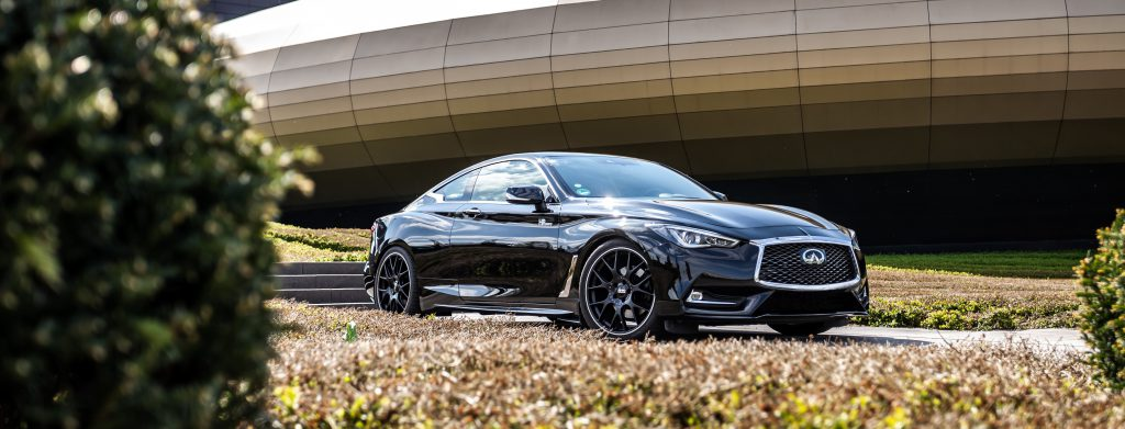 Infiniti Q60 parked in front of building featuring HP Tuners software.