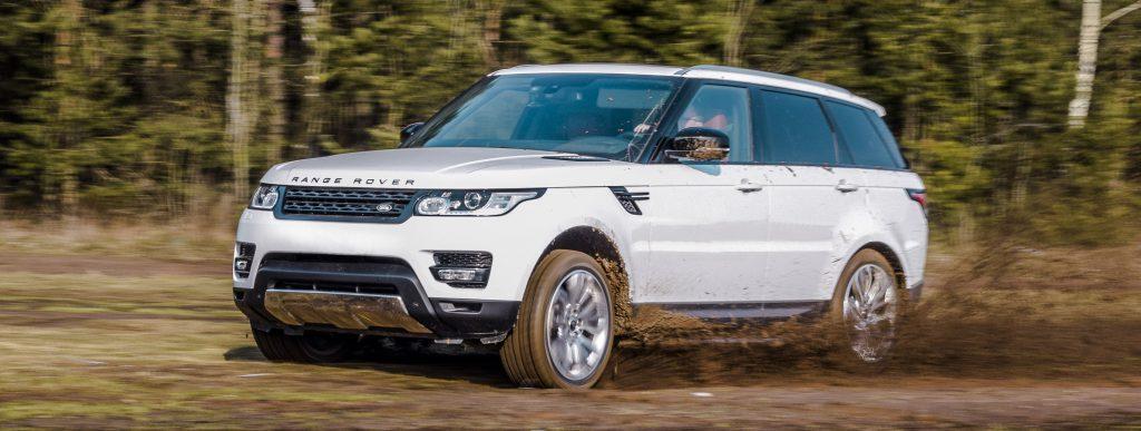 2015 Range Rover Sport exploring some rough terrain going through the mud.